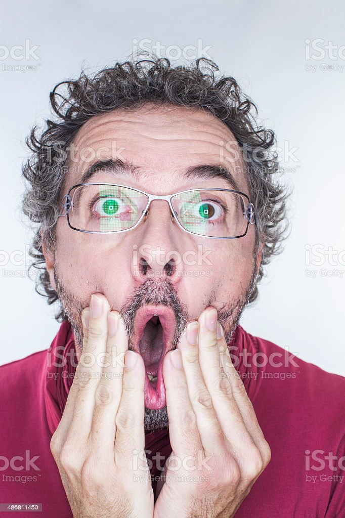 male jaw dropping for scary news stock photo