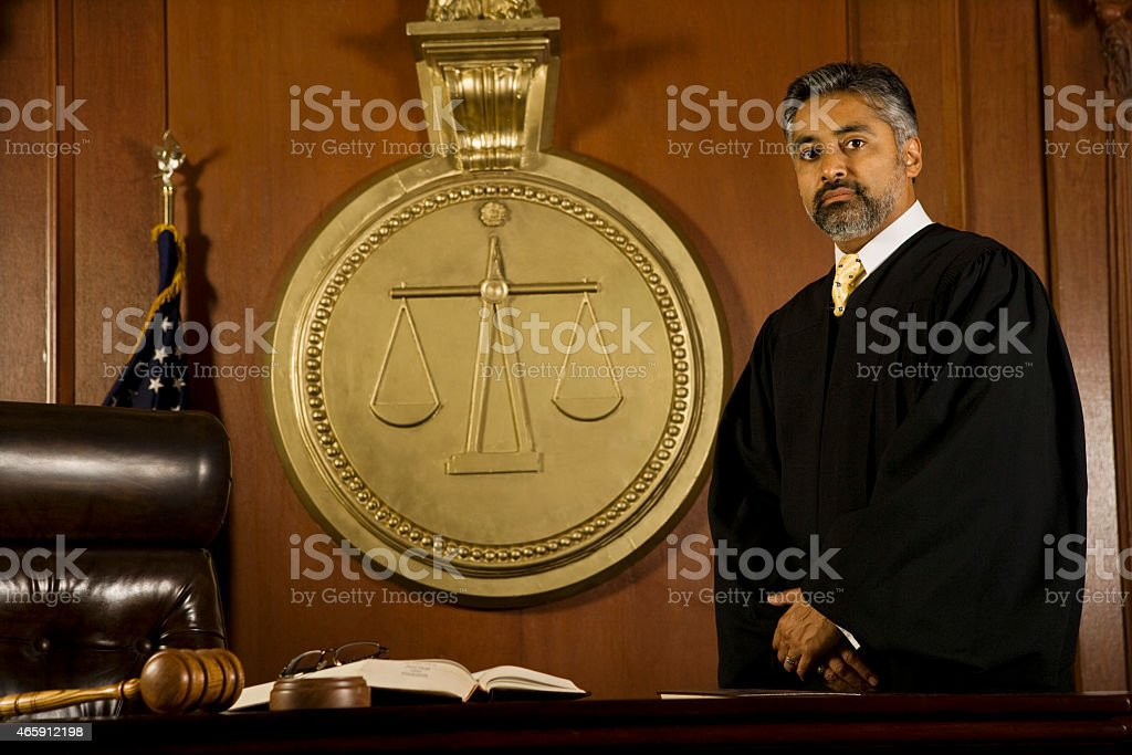 Male Judge Standing In Court Room stock photo
