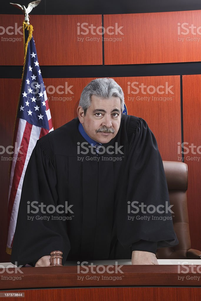 Male Judge With Gavel in Courtroom royalty-free stock photo