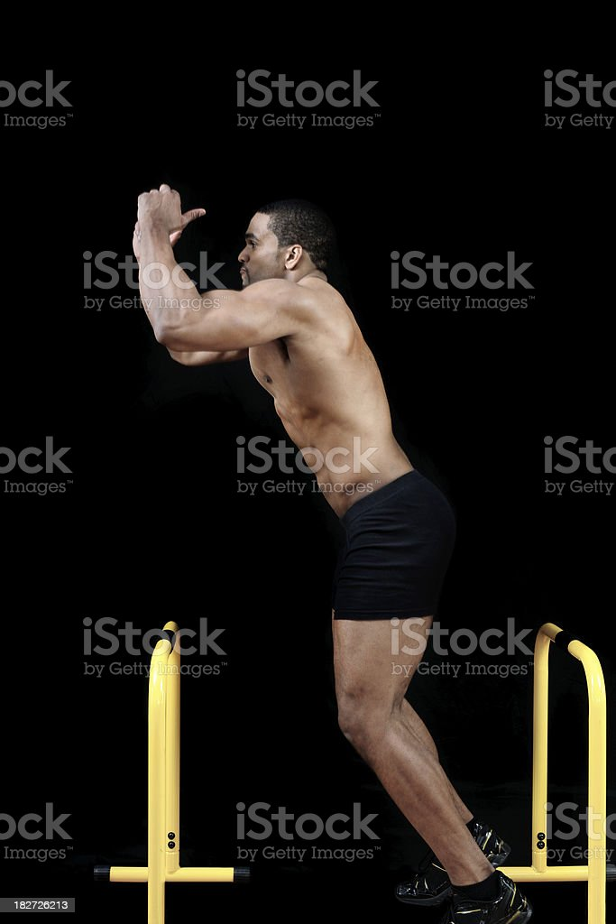 male jumping step or hurdle royalty-free stock photo