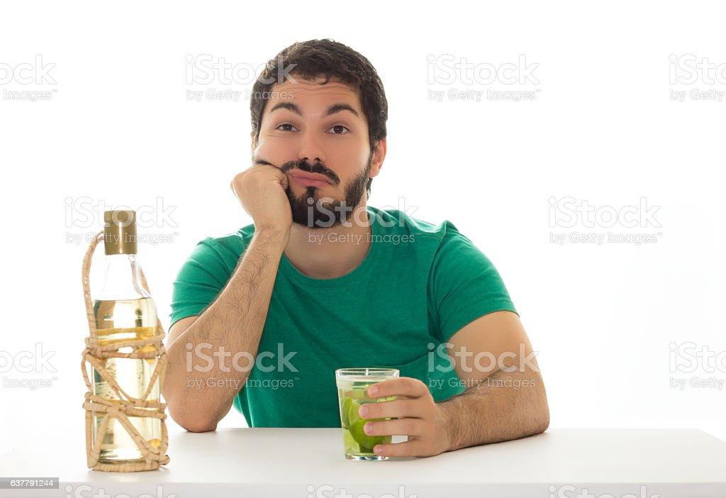 Male looking bored at bar table. stock photo