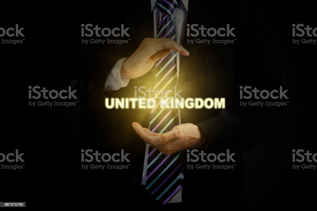 Male manager with United Kingdom word stock photo