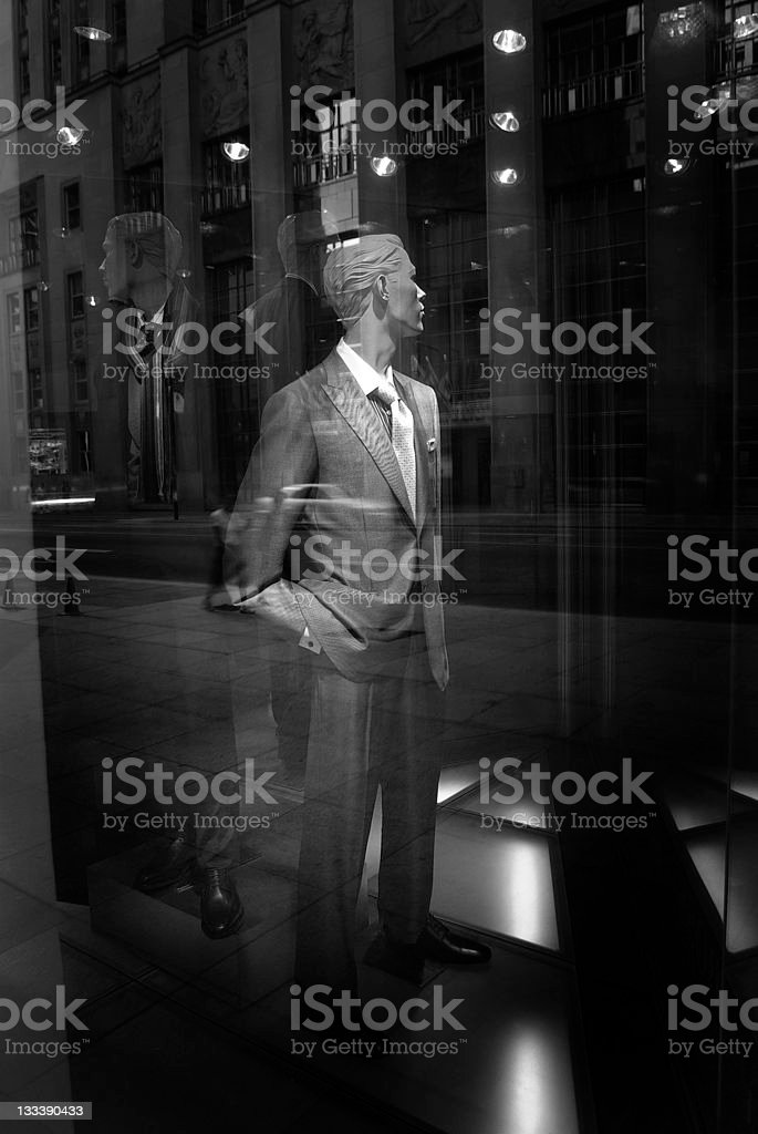 male Mannequin behind store glass window royalty-free stock photo