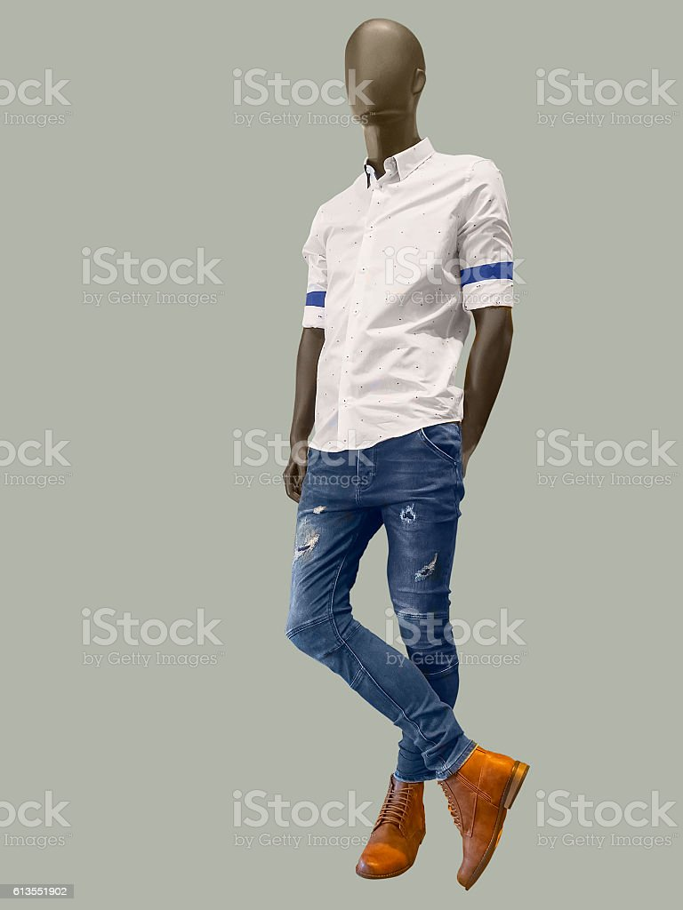 Male mannequin dressed in shirt and blue jeans stock photo