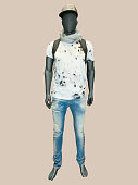 Male mannequin dressed in t-shirt and jeans.
