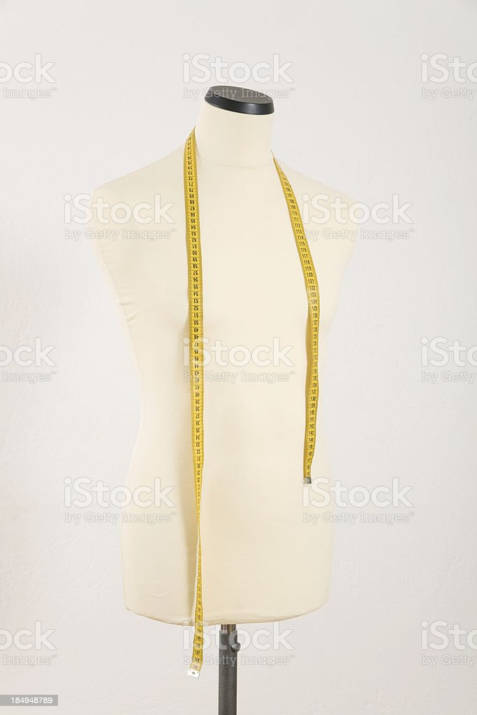 Male mannequin with yellow tape measure stock photo
