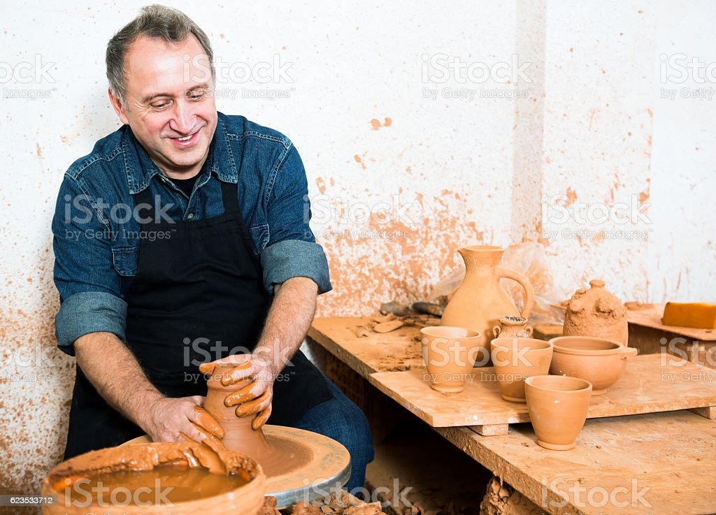 Male master among the pottery stock photo