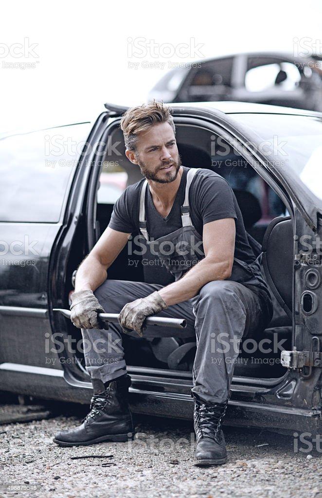 Male mechanic at junkyard stock photo