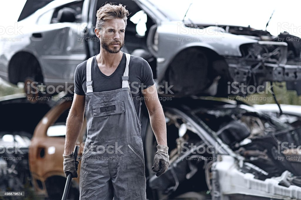 Male mechanic at junkyard stock photo