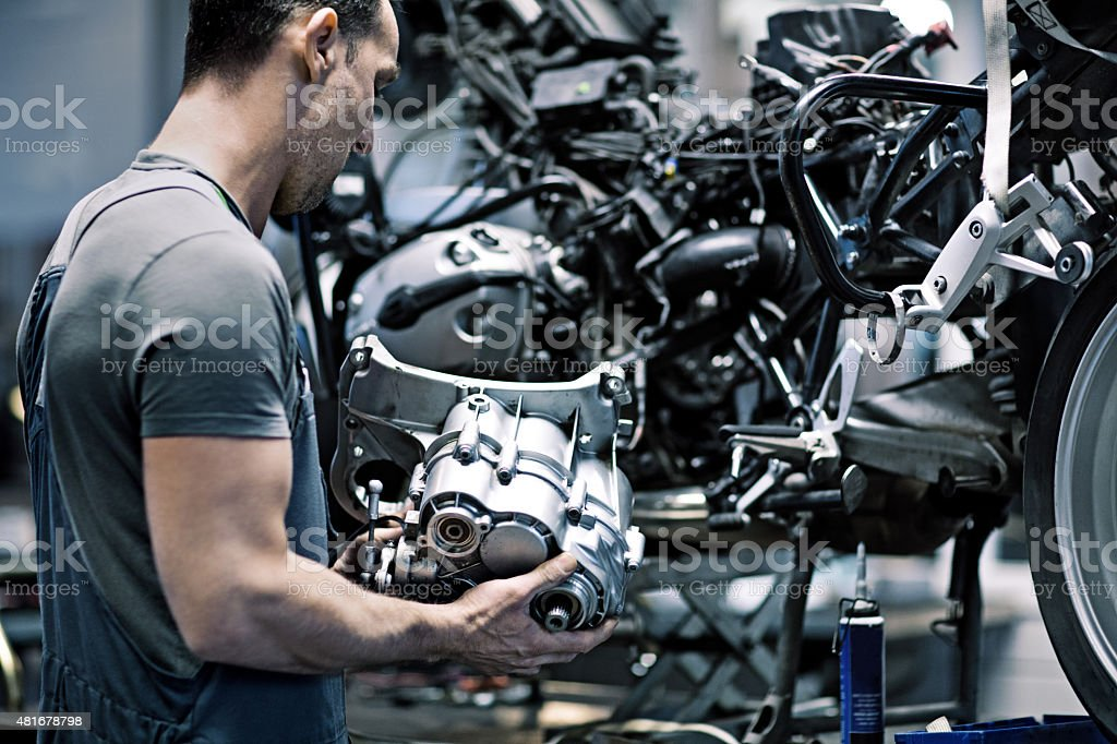 Male mechanic in a repair workshop stock photo
