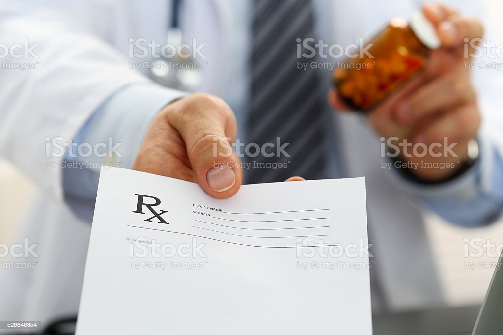 Male medicine doctor hand hold jar of pills stock photo