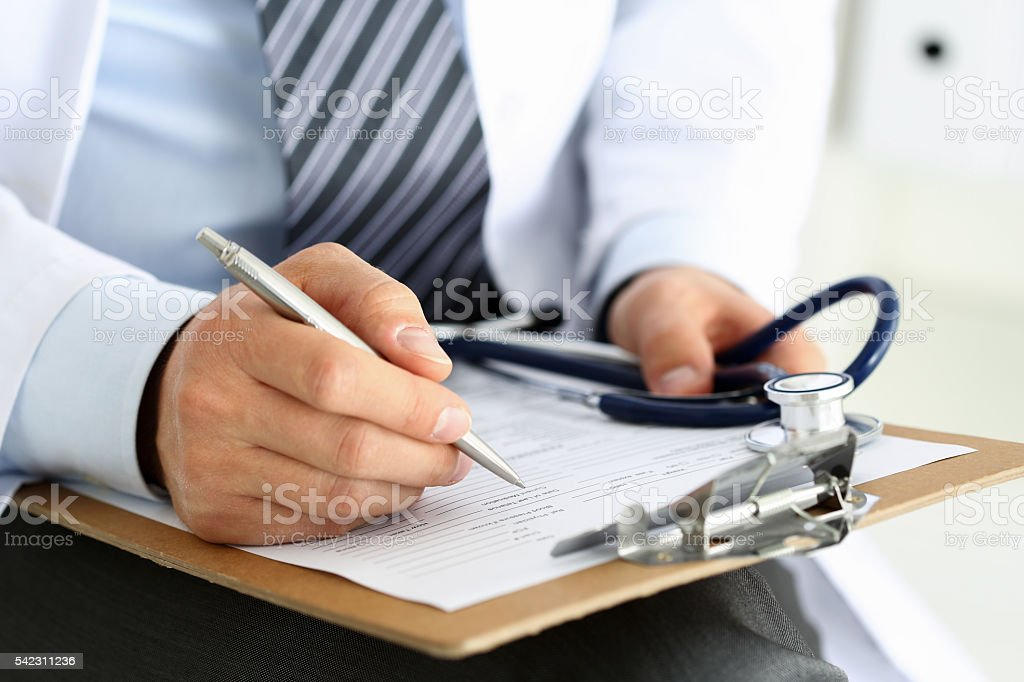Male medicine doctor hand holding silver pen writing stock photo