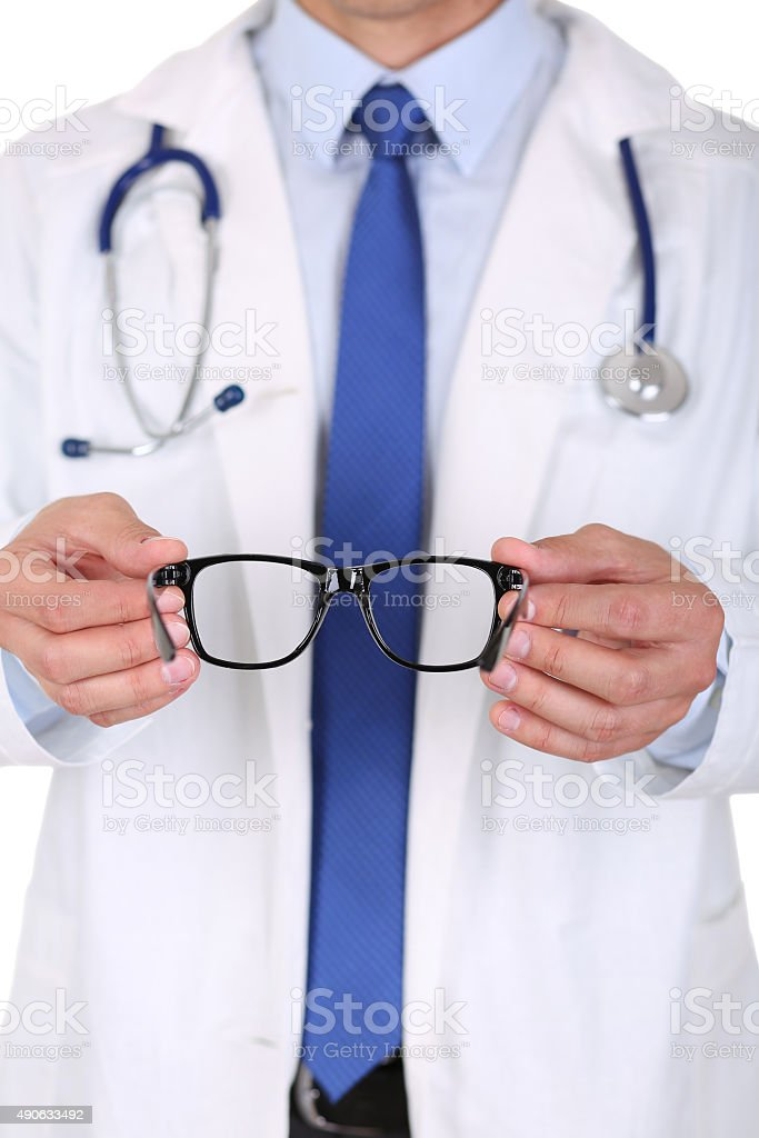 Male medicine doctor hands giving pair of black glasses stock photo