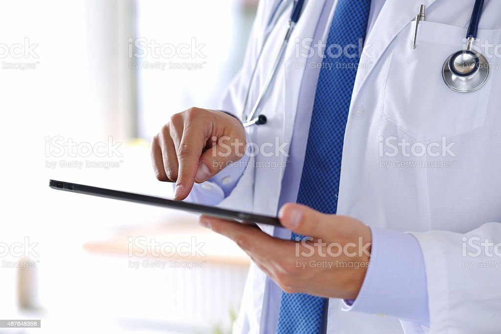 Male medicine doctor holding digital tablet pc stock photo