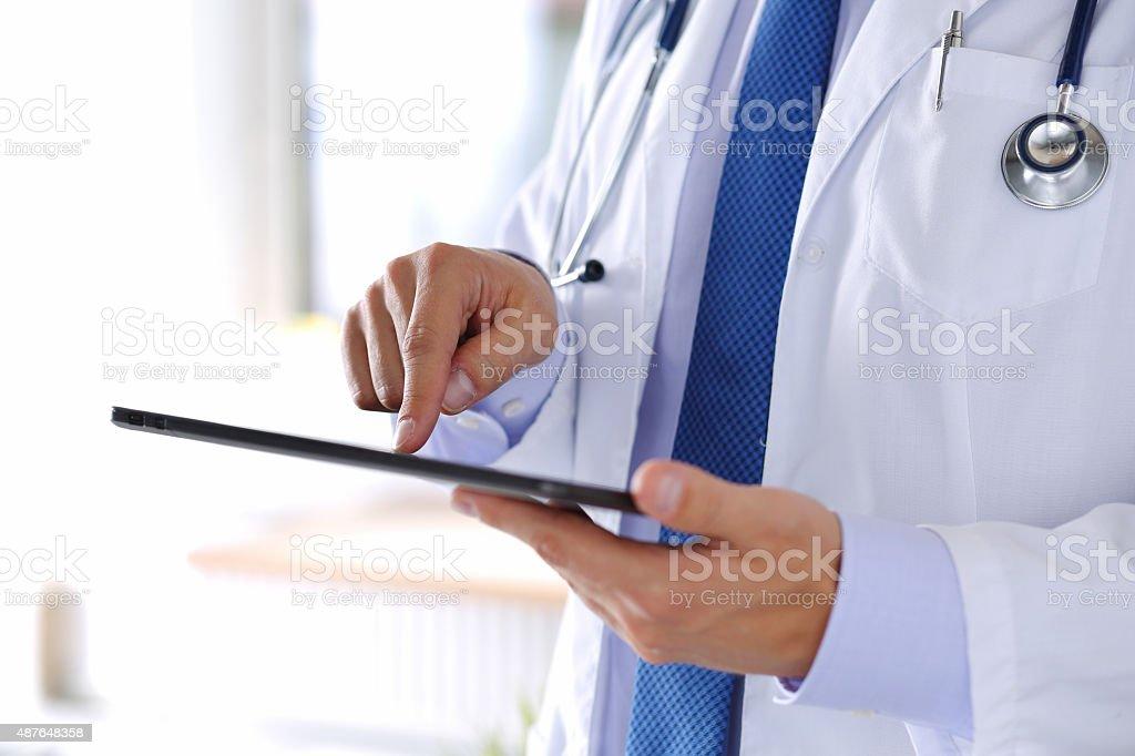 Male medicine doctor holding digital tablet pc stock photo