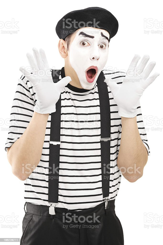 Male mime artist gesturing excitement with his hands stock photo