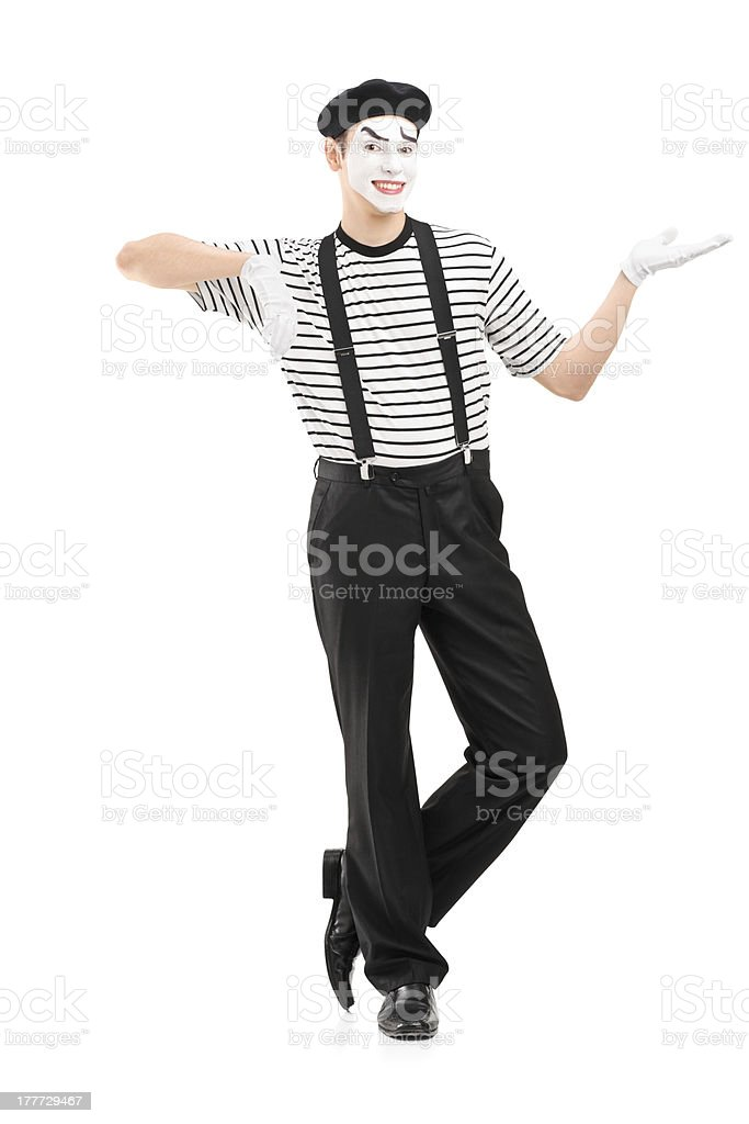 Male mime artist gesturing with hand stock photo