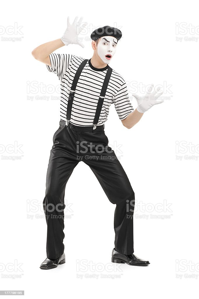 Male mime artist performing against a plain background stock photo