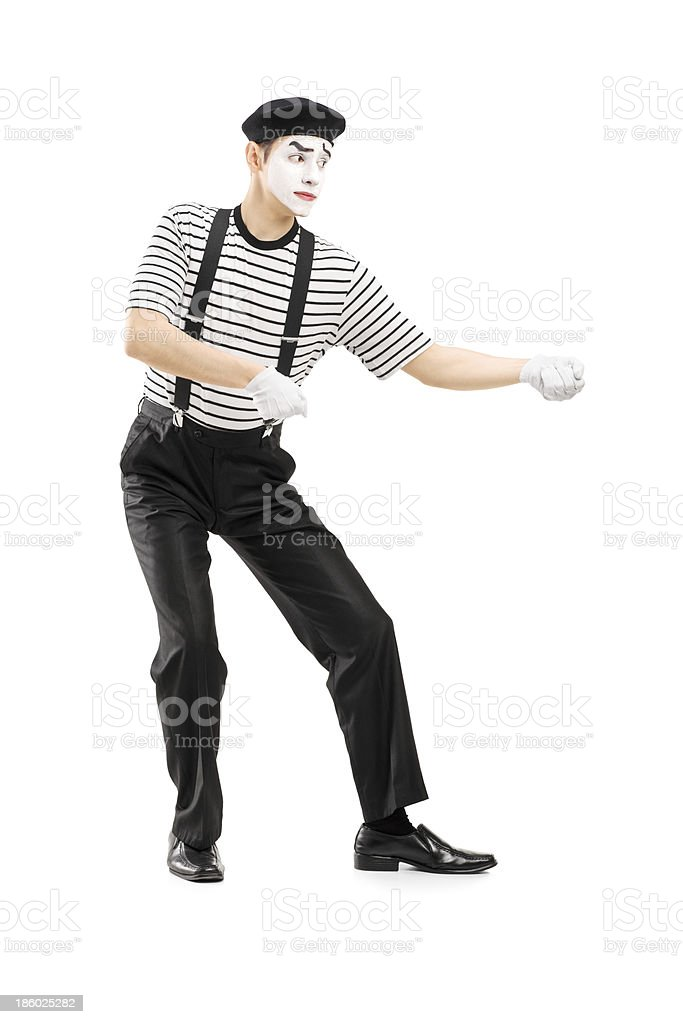 Male mime artist performing pulling virtual rope stock photo