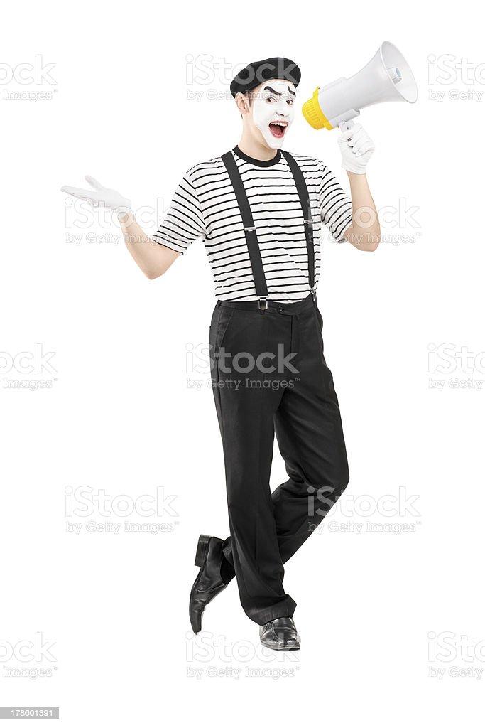 Male mime artist speaking at loudspeaker stock photo