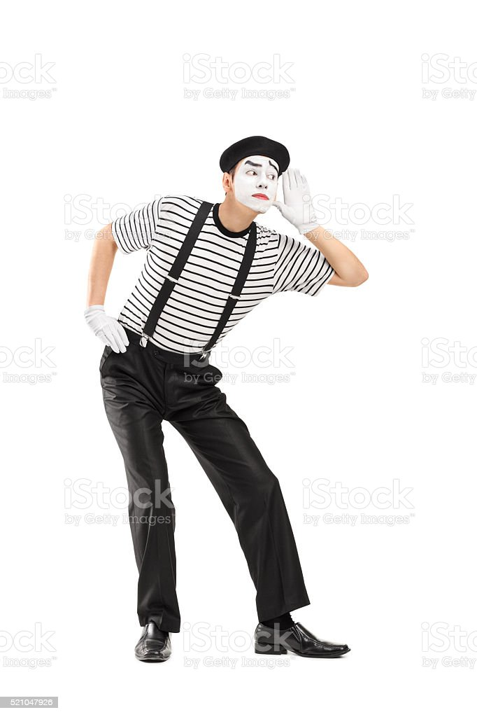 Male mime artist trying to hear something stock photo