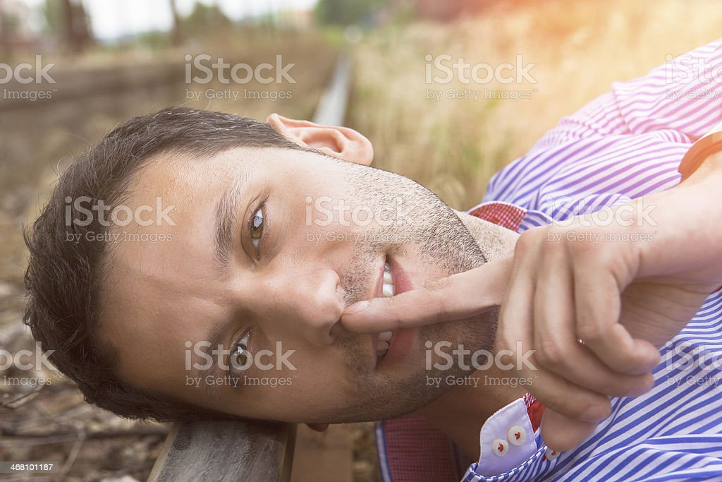 male model lying on the rail stock photo