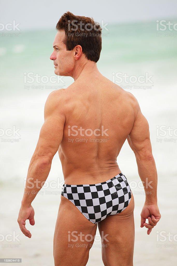 Male model posing on the beach stock photo