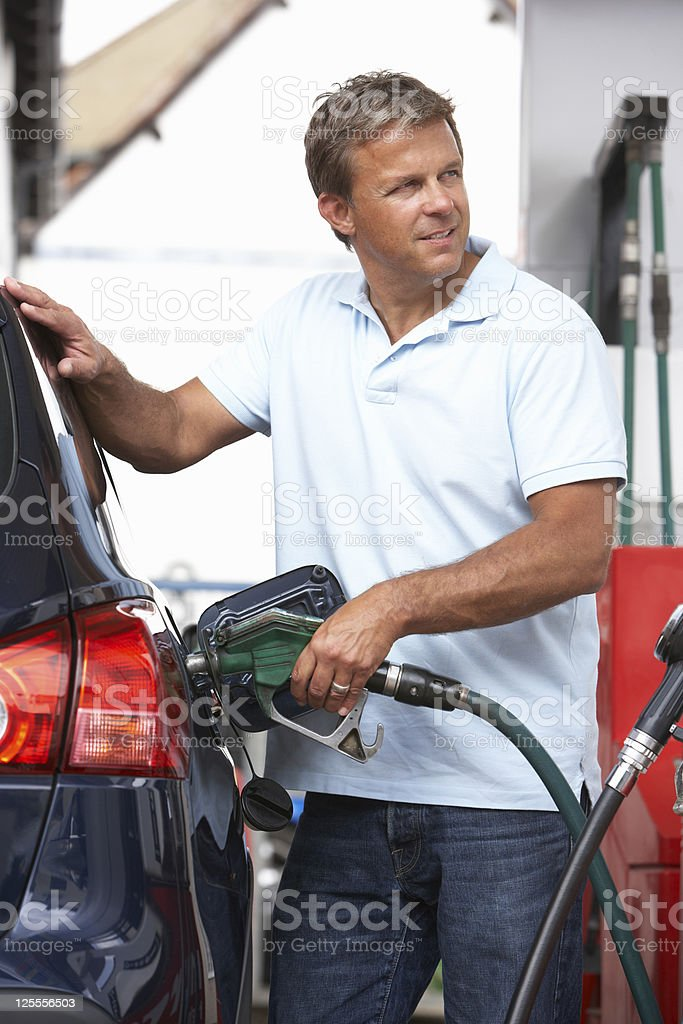Male Motorist Filling Car With Diesel stock photo