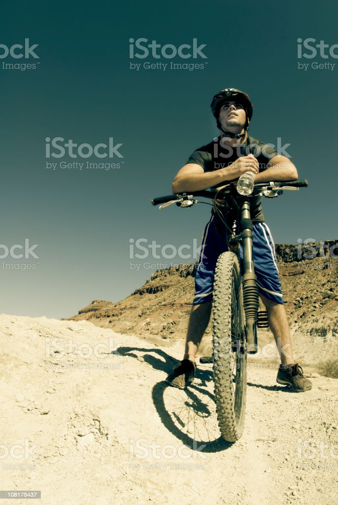 Male Mountain Biker Resting with water bottle royalty-free stock photo