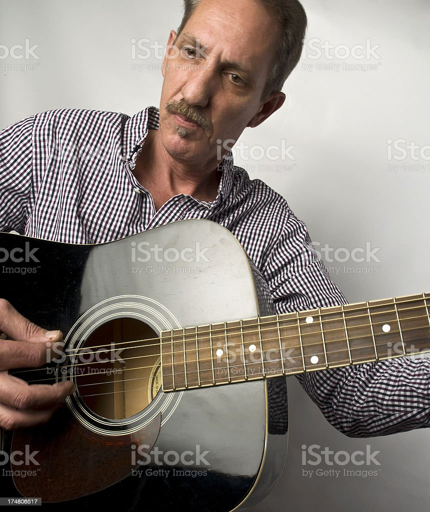 Male Musician Playing Acoustic Guitar royalty-free stock photo