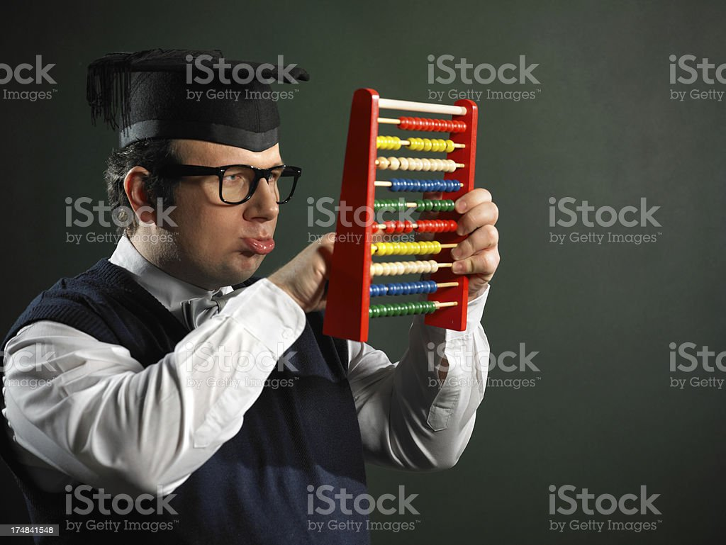 Male nerd holding abacus royalty-free stock photo