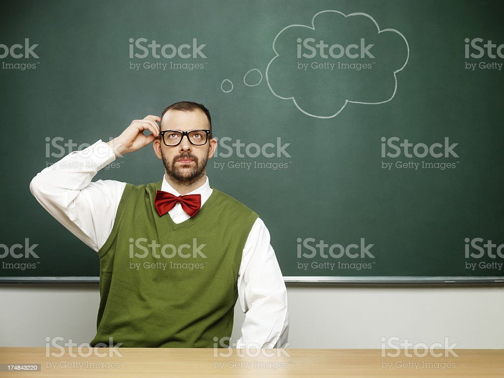 Male nerd thinking royalty-free stock photo