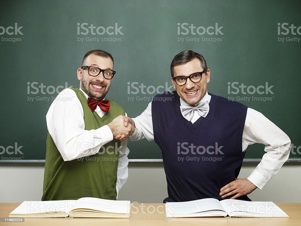 Male nerds celebrating success royalty-free stock photo