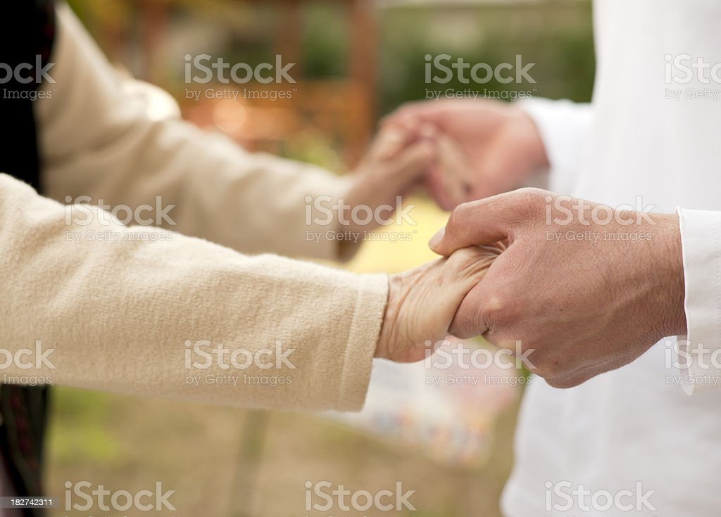 Male nurse helping to old woman for walking royalty-free stock photo