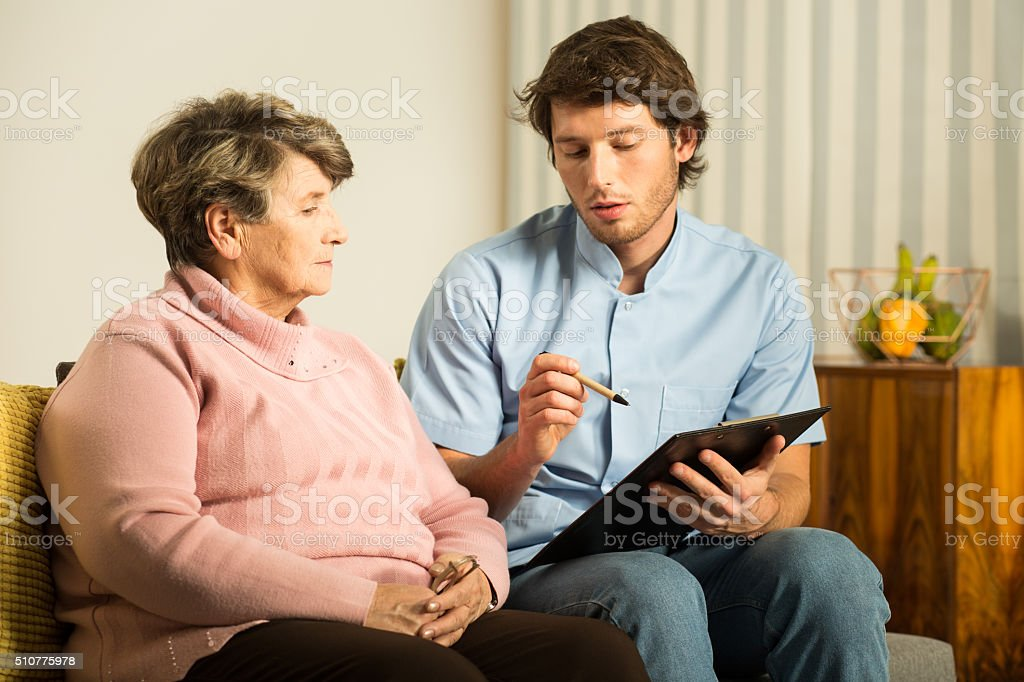 Male nurse in rest home stock photo