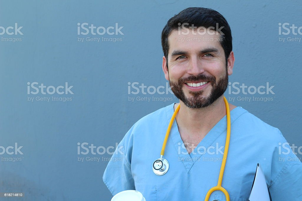 Male nurse smiling with confidence stock photo