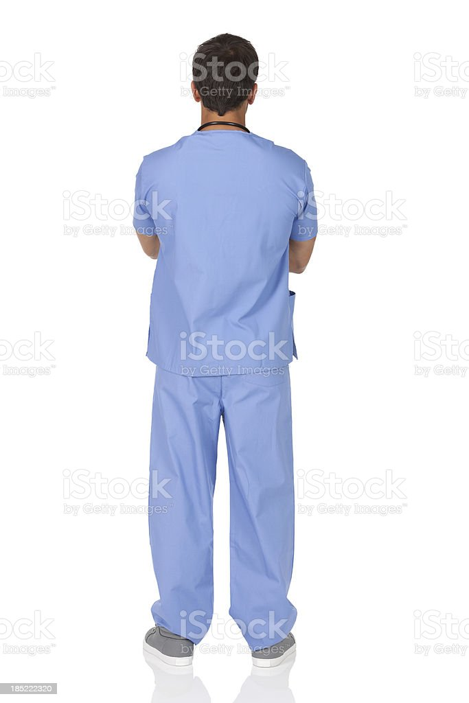 Male nurse standing with his arms crossed stock photo