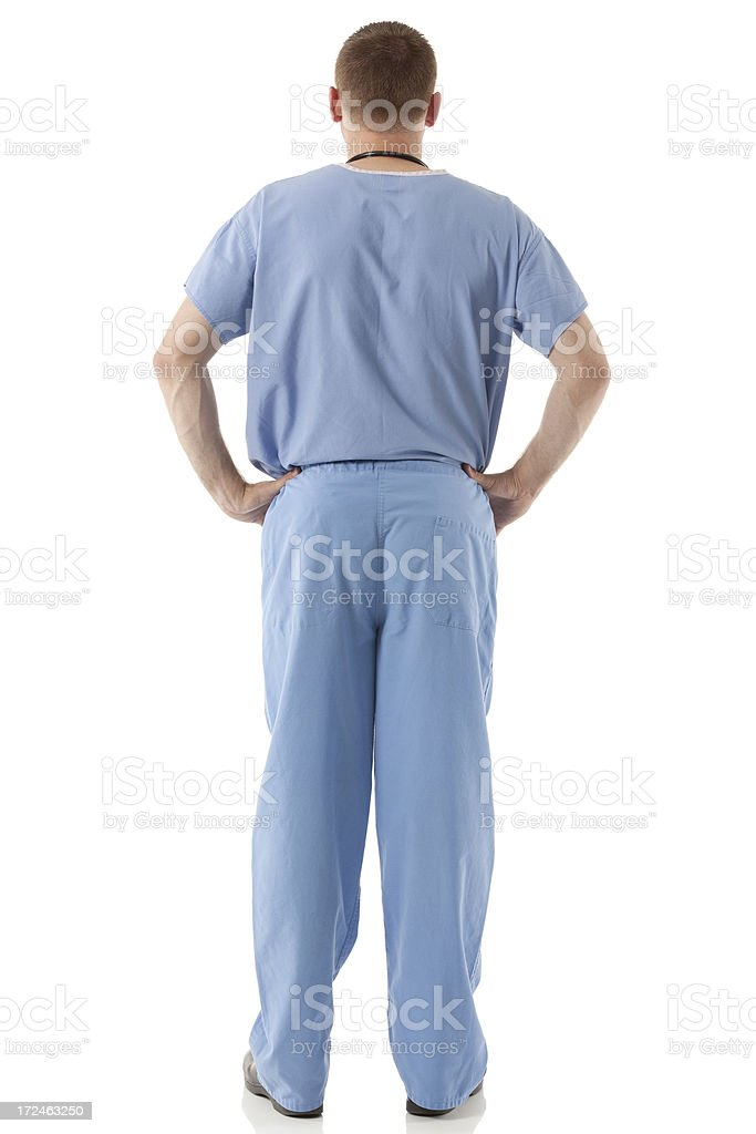 Male nurse standing with his hands on hips royalty-free stock photo