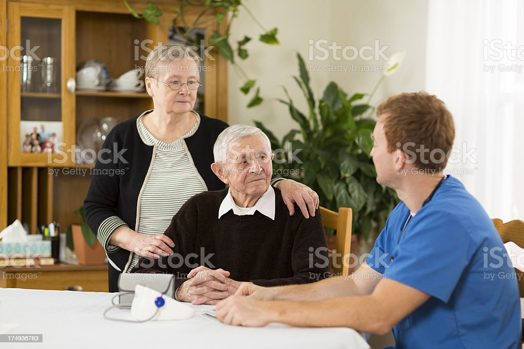 Male nurse visiting a senior couple royalty-free stock photo