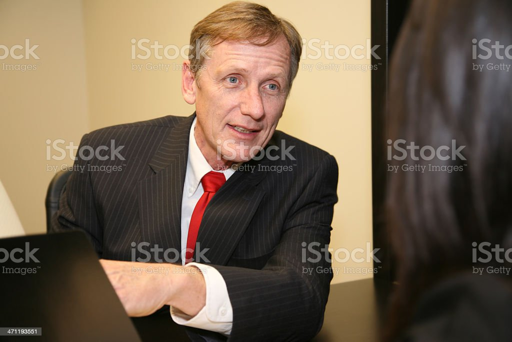 Male Office Worker Explaining Work to Female Co-Worker royalty-free stock photo