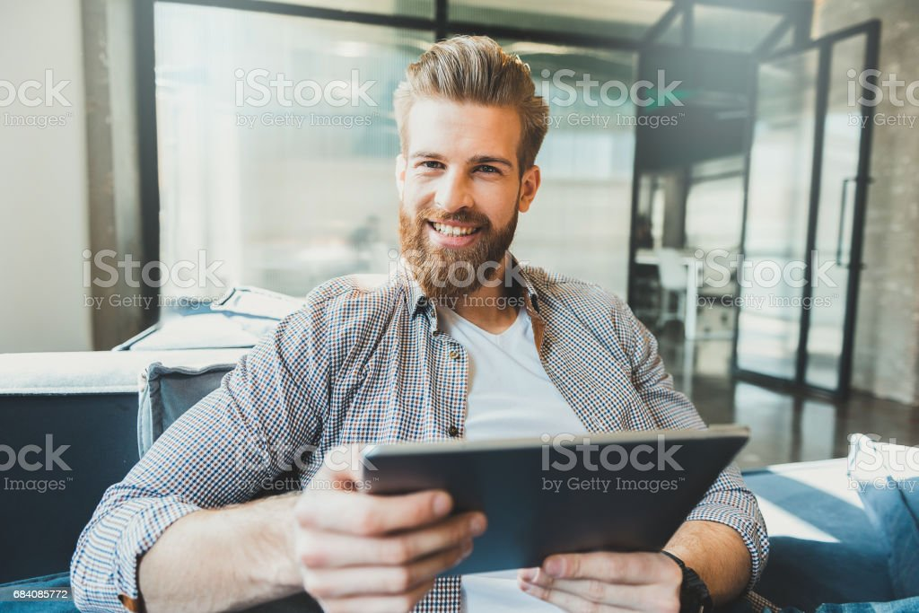 Male office worker happily smiling stock photo
