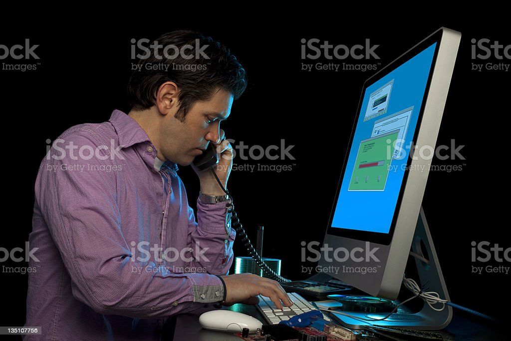 Male Office Worker On Phone At Computer Console Black Isolated royalty-free stock photo