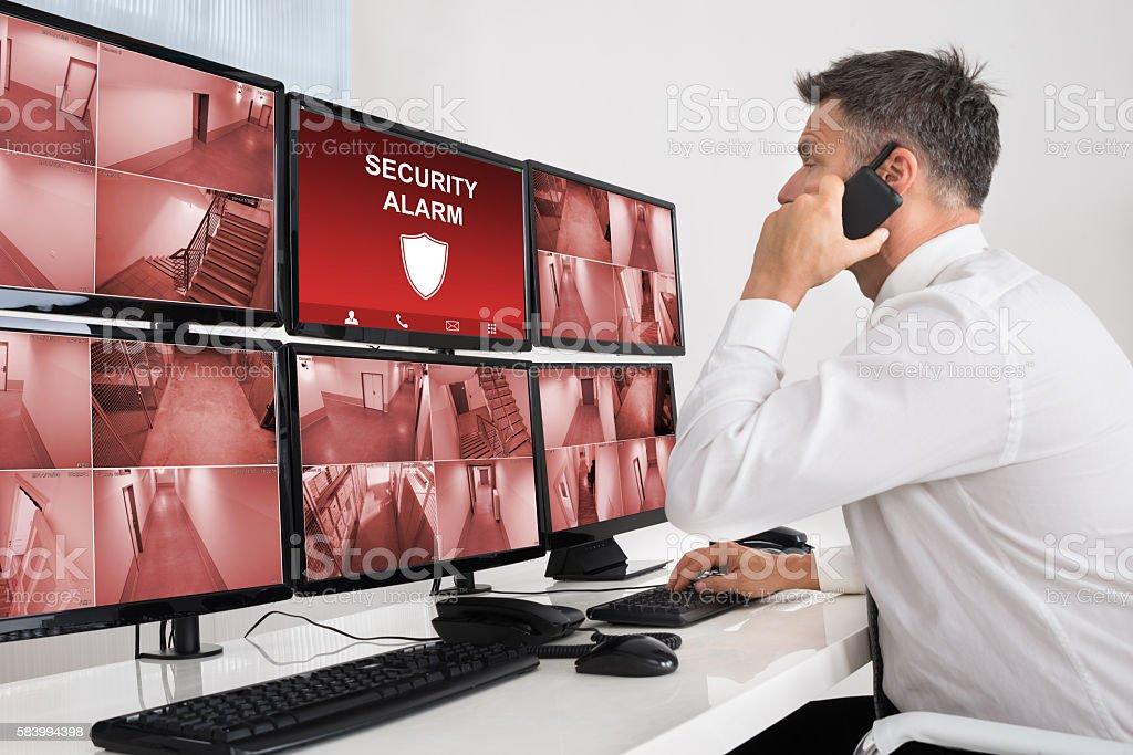 Male Operator Using Walkie-talkie stock photo