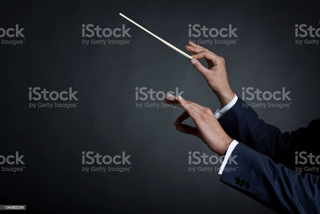 male orchestra conductor stock photo