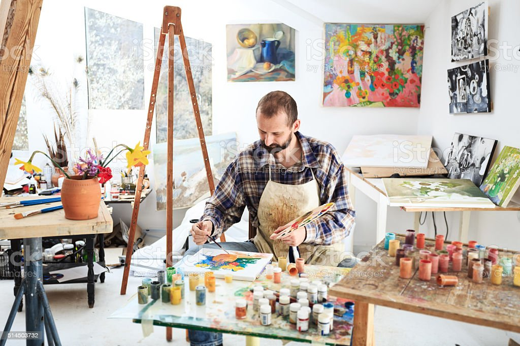 Male painer drawing in his studio stock photo