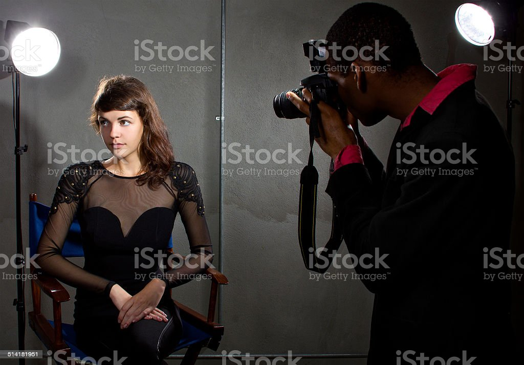 Male Paparrazi Photographer and a Female Actress stock photo