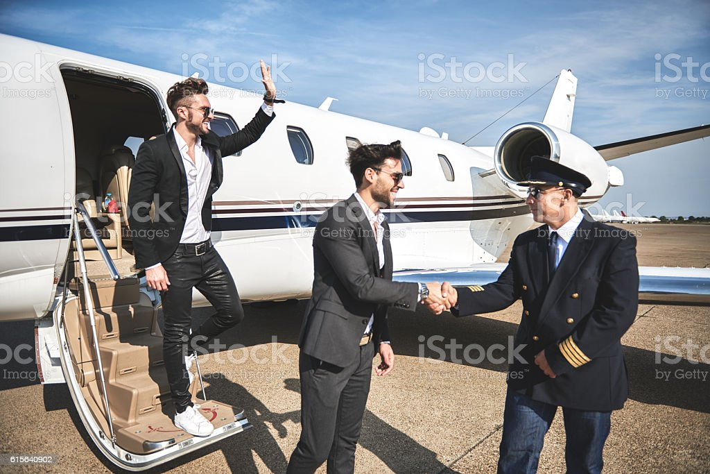 Male passenger shaking hands with pilot stock photo