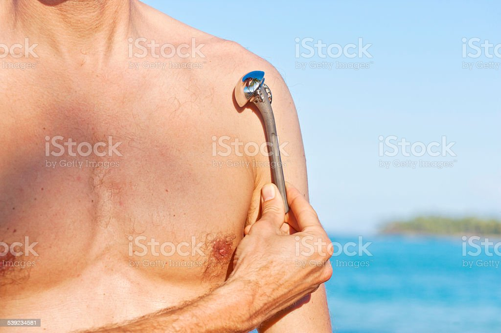 Male person demonstrating shoulder prosthesis stock photo