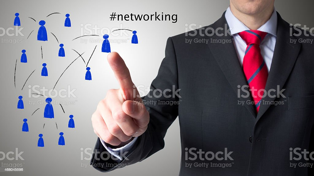Male person using a virtual touch screen – networking stock photo
