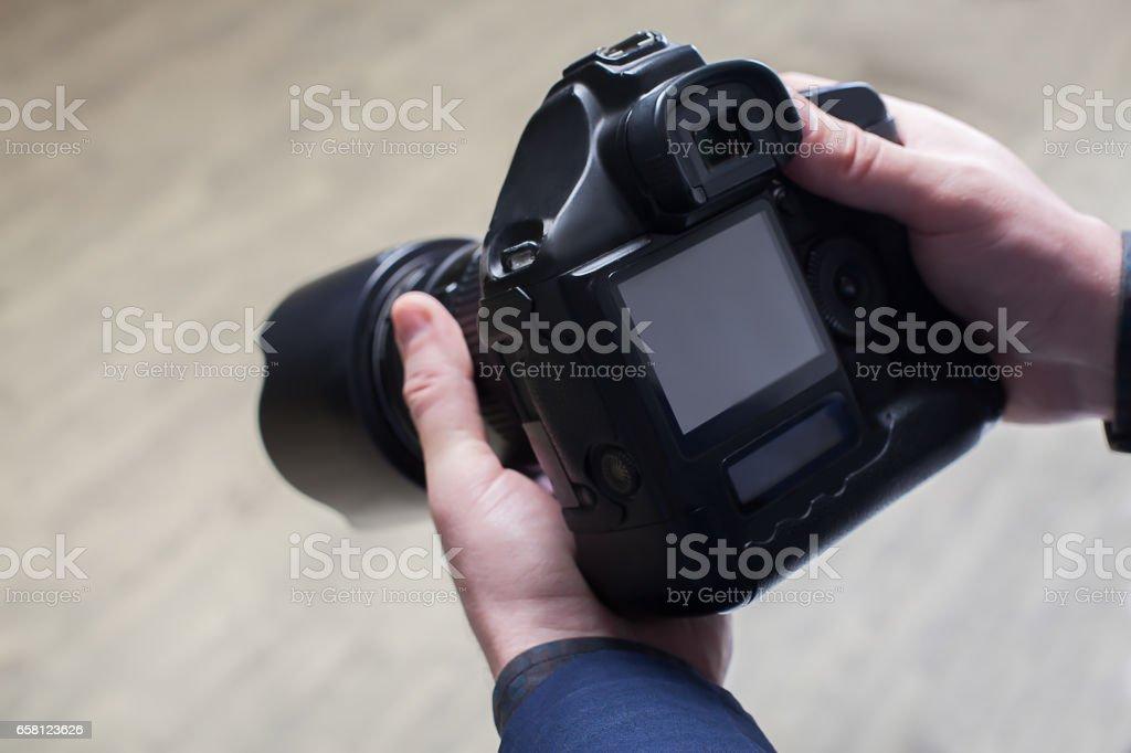 Male photographer hands holding digital camera stock photo